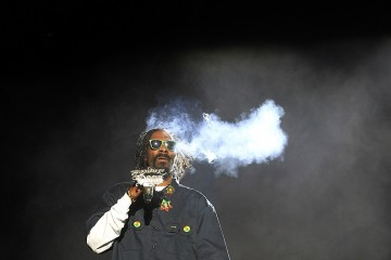 Snoop Dogg smokes a blunt onstage at the Coachella Valley Music and Arts Festival, April 13, 2012 in Indio, California. (Luis Sinco/Los Angeles Times/MCT)