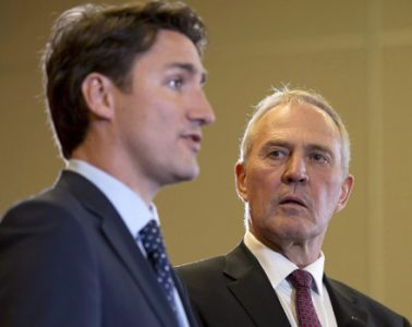 Bill Blair (right), a former Toronto police chief who is now one of two parliamentary secretaries to the minister of justice, was assigned the cannabis legalization file by Prime Minister Justin Trudeau.