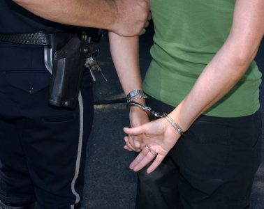 Demo_arrest,_handcuffed