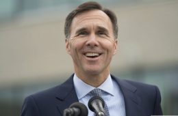 Minister of Finance Bill Morneau smiles during an outdoor news conference in the courtyard of a college in Ottawa on Monday September 26, 2016. THE CANADIAN PRESS/Adrian Wyld